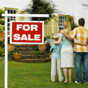 Two generation family looking at a house for sale